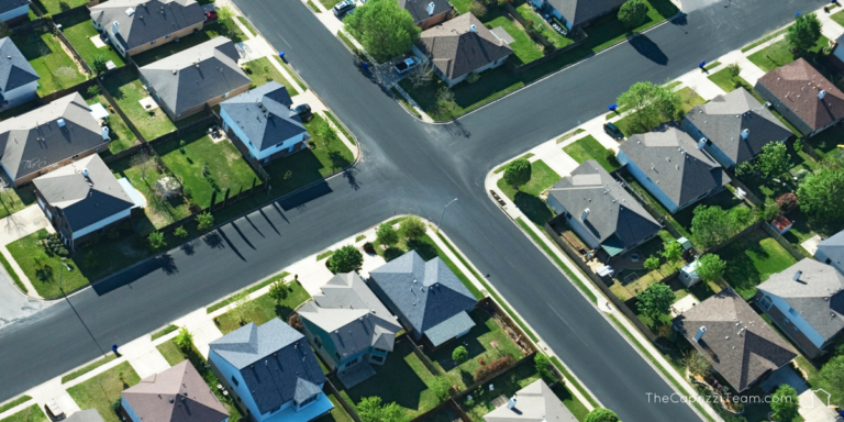 Neighborhood street intersection, view of the tops of houses